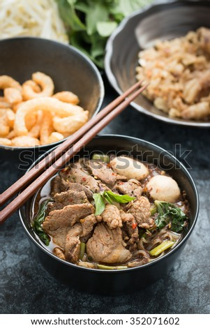 """spicy thai pork noodle, boat Noodle, """"Kuay Tiew Rua"""" with pork rind and pork Crackling - stock photo"""