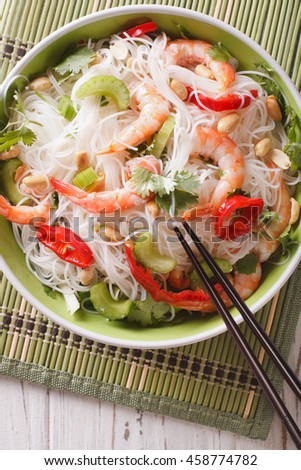 spicy Thai salad yam woon sen with seafood close up on a plate. vertical view from above - stock photo