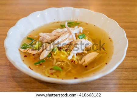 Spicy TOM YAM chicken noodle soup with lemongrass, chilly pasted and lime juice - stock photo