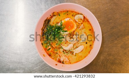 Spicy TOM YAM pork noodle soup with lemongrass, chilly pasted and lime juice - stock photo