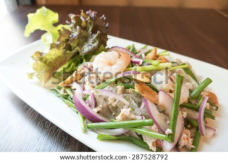 Spicy vermicelli salad on white plate