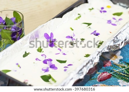 Spicy whipped gelatin cream with vegetable and egg and edible blooming spring flower, spring and easter traditional food in Czech republic - stock photo