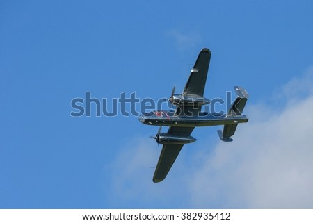 SPIELBERG, AUSTRIA - OCTOBER 26, 2014: B-25 Mitchell flys in a flight display during the Red Bull Air Race. - stock photo
