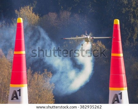 SPIELBERG, AUSTRIA - OCTOBER 25, 2014: Martin Sonka (Czech Republic) competes in the Red Bull Air Race. - stock photo
