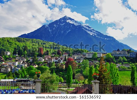Spiez, beautiful village in swiss Alps - stock photo