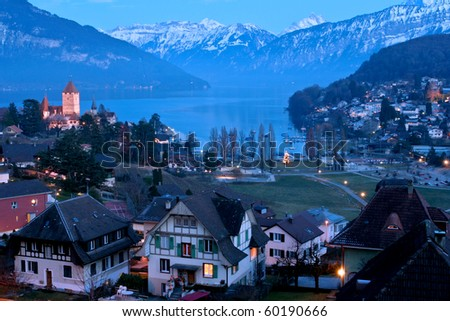 Spiez castle and Alps night scene Switzerland