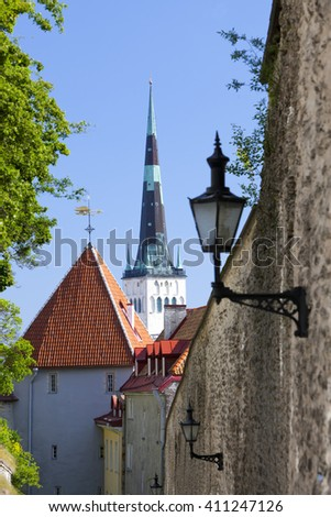 spike of St Olaf (Oleviste) Church and fortification tower. Tallinn, Estonia