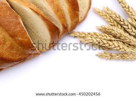 Spikes of wheat and a loaf of bread. Isolated object. Agriculture concept