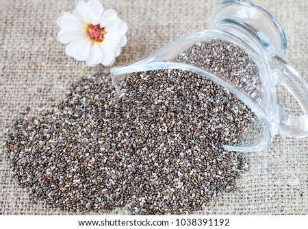 Spilled chia seeds on a linen tablecloth