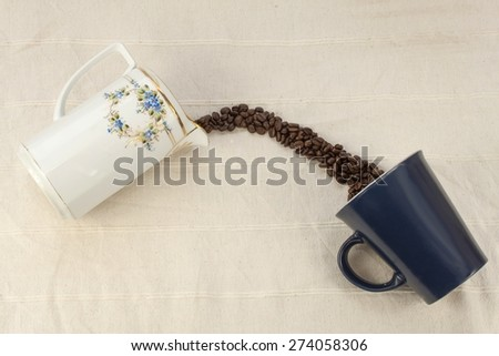 spilled coffee beans, coffee mug, old coffee grinder, Way of coffee beans - stock photo