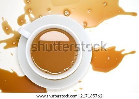 Spilled Coffee on White Desk - stock photo