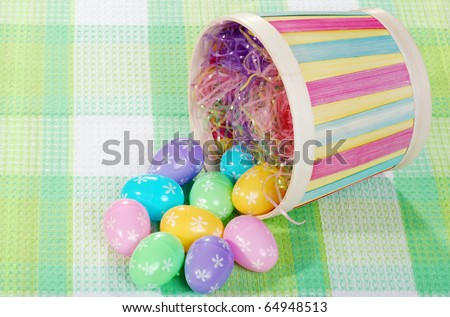 spilled easter eggs and basket - stock photo