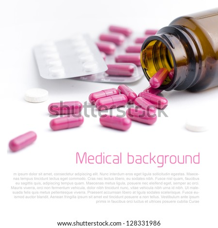 Spilled pills out of the bottle - background with copyspace - stock photo