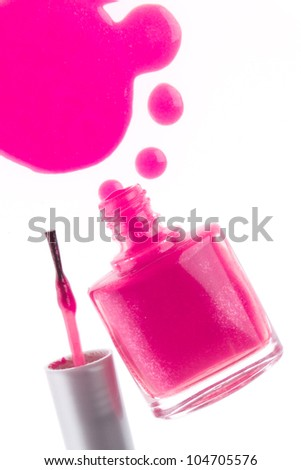 spilled pink nail polish isolated on white background - stock photo