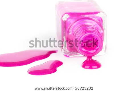 Spilled pink nail varnish, closed-up on white