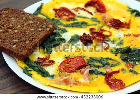Spinach, bacon and tomato omelette. Breakfast