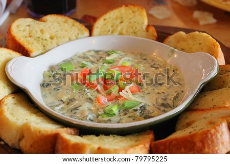 Spinach dip with bread - stock photo