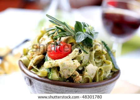 Spinach fettuccine with chicken and cream - stock photo