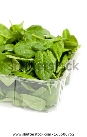 Spinach in a plastic container