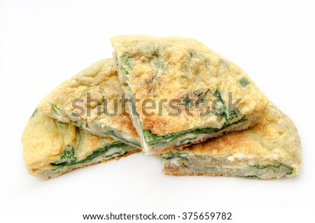 Spinach omelet on white background - stock photo