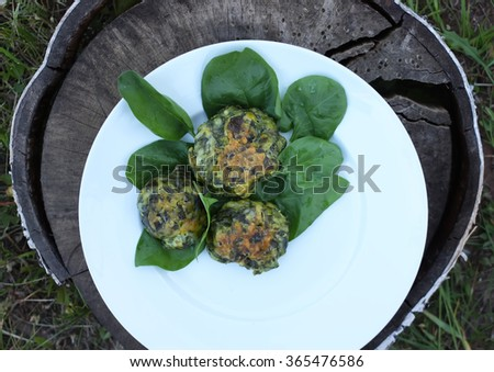 Spinach pancakes. - stock photo