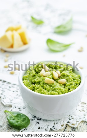 spinach pesto on a white background. the toning. selective focus - stock photo