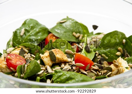 Spinach salad in transparent bowl - stock photo