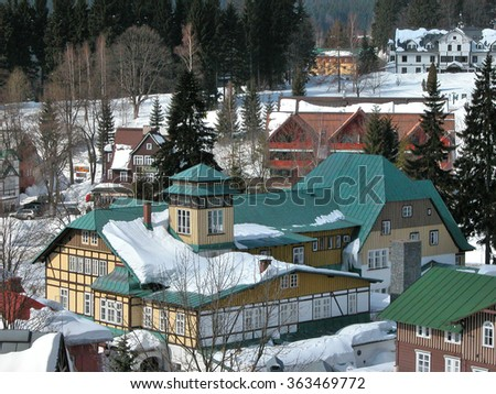 SPINDLERUV MLYN, CZECH REPUBLIC - MARCH 23, 2006: Top view of the guesthouses during the winter season in Karkonosze mountains resort. - stock photo