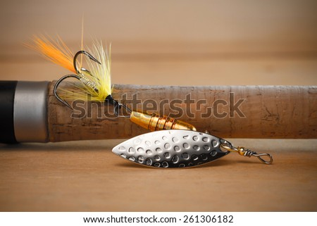 spinners lure close-up on the handle spinning - stock photo