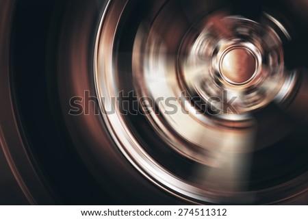 Spinning Car Wheel Closeup Photo. Car Alloy Wheel in Motion. - stock photo