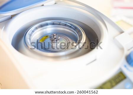 Spinning centrifuge - stock photo