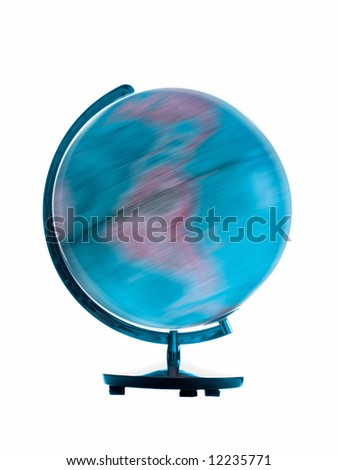Spinning globe showing motion blur on white background - stock photo