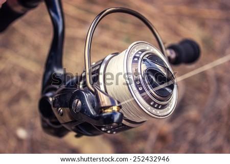 Spinning rod, reel, fishing line - stock photo