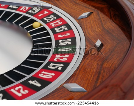 spinning roullette wheel in a casino - stock photo