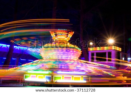 Spinning twister showing light traces at night. Motion blur. - stock photo