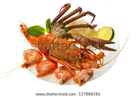 Spiny lobster, shrimps, crab legs  and rice - stock photo