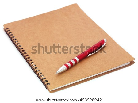 Spiral bound organizer with ballpoint on it over white background - stock photo