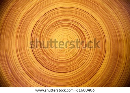 spiral circular bamboo textured background of wooden table - stock photo