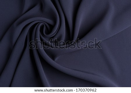 Spiral folds on grey cloth. High resolution texture - stock photo