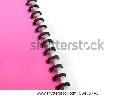 spiral lined pink file isolated on white - stock photo