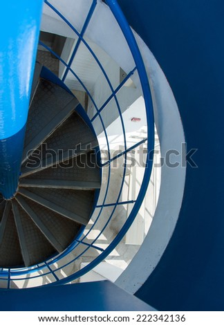Spiral metal stairway going down stair - stock photo