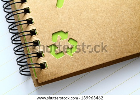 Spiral note with recycle mark
