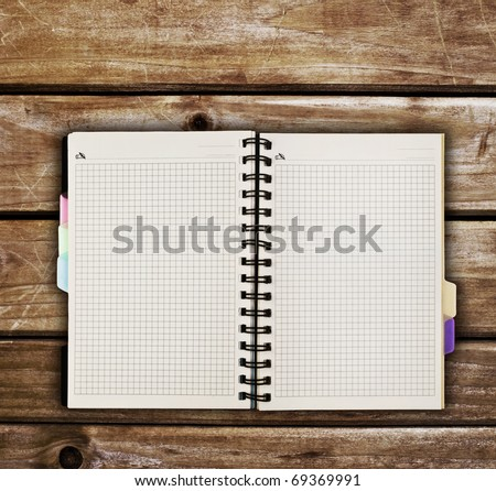 spiral notebook on  wooden table - stock photo