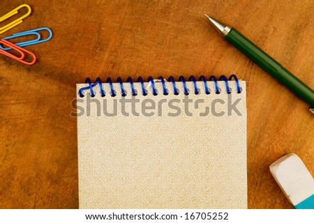 Spiral Notepad,mechanic pencil, eraser and clips - stock photo