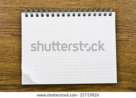 Spiral  notepad on wooden background