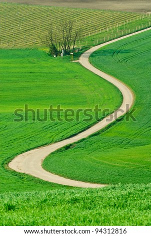 Spiral path zigzags along the village sacred chapel - stock photo