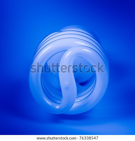 Spiral power saving up lamp - stock photo