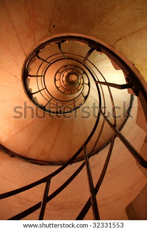 Spiral Stair Case looking up to the top of the Arc de Triomphe - stock photo