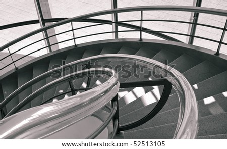 Spiral staircase with metal bar