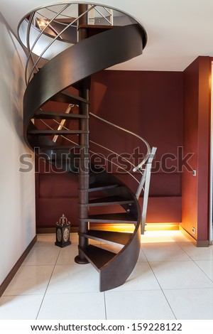 Spiral wooden staircase in a modern luxury house - stock photo